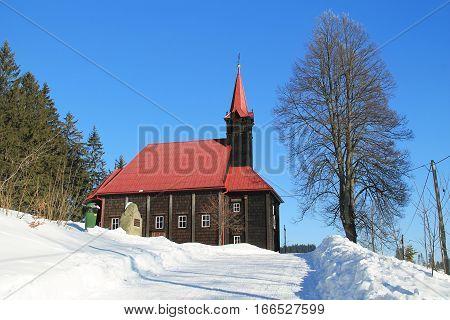 wooden church on Grun in Beskydy mountains, Czech Republic in winter