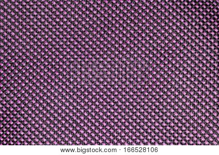 Pink fishnet cloth material as a texture background. Nylon texture pattern or nylon background for design with copy space for text or image.