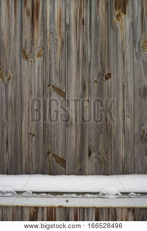 Wooden Fence in winter. Front view with empty spase. Wooden background. Free space for design