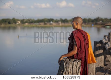 Mandalay Myanmar November 15th 2014: young monks walking on U Bein bridge