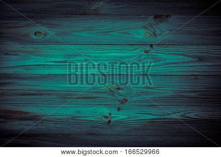 Dark blue background wooden texture. Front view with empty spase. Horisontal boards.