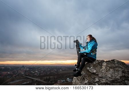 Female Photographer With Camera On Tripod On The Big Rock