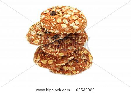 Cookies covered with nuts and raisins isolated on white background