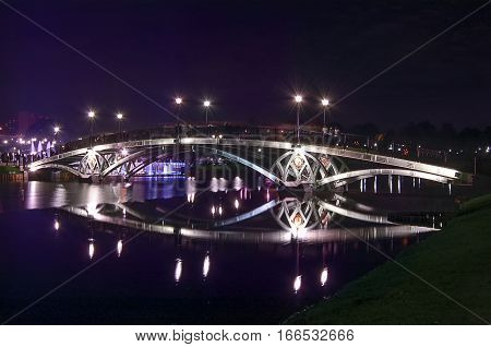 the lights on the bridge at night in the Tsarytsyno Park