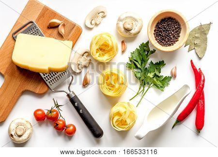 ingredients for cooking paste on white background top view.