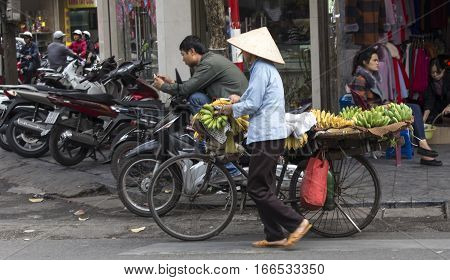 Street Vendor Transporting And Selling Bananas