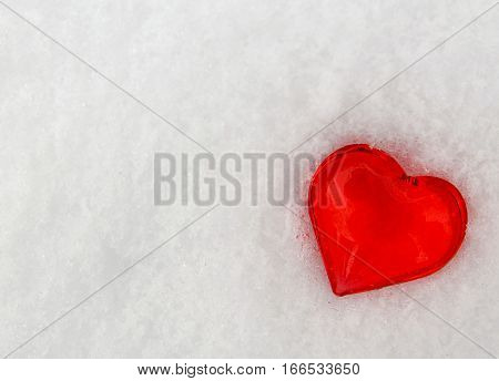 Decorative red heart on snow background.Valentine's Day heart. Valentine heart.Saint Valentine's Day or Love concept.Selective focus.