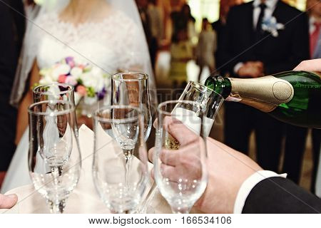 Celebrating And Toasting Happy Group Of People With Champagne At The  Wedding Reception