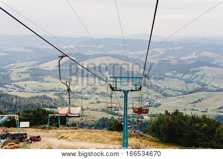 Old Lift Hoist At Top Of Mountains With Amazing View, Empty Chairs Chairlift, Travel Adventure Conce