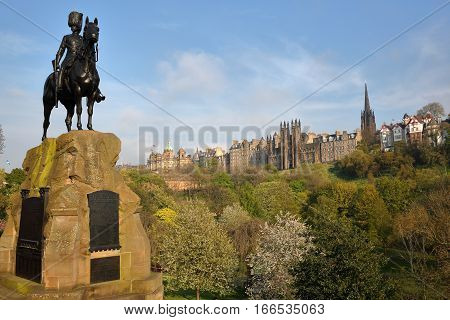 EDINBURGH, SCOTLAND - MAY 8, 2016: The Royal Scots Greys Monument at Princes Street Gardens with spring colors