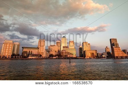 LONDON UK - 31 MARCH 2016: A dusk view of the waterfront and skyline of the skyscrapers to the Docklands business district in East London.