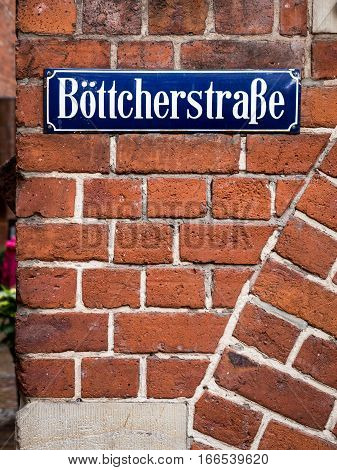 The street sign within the historic centre of Bremen Germany. The district is famous for its old original and unusual red brick architecture. Böttcherstraße translates into English as Cooper Street.