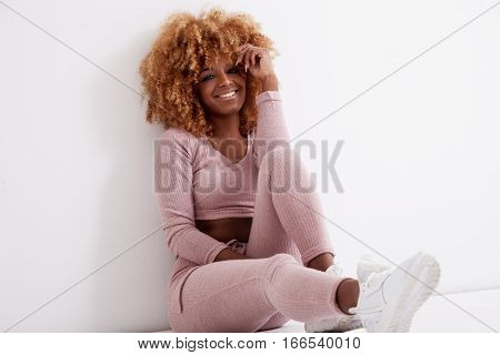 Black Woman With Long Nails And Blonde Afro Hair