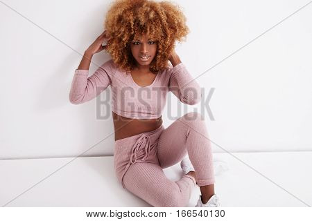 Black Woman Touches Her Curly Blonde Hair