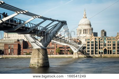 St. Paul's Cathedral And The Millennium Bridge Over The River Thames, London