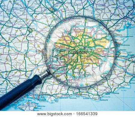 Detail Of A Magnifying Glass Over A Road Map Of London England