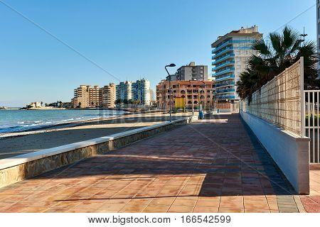Empty promenade of La Manga or La Manga del Mar Menor is a seaside spit in the Region of Murcia Spain.