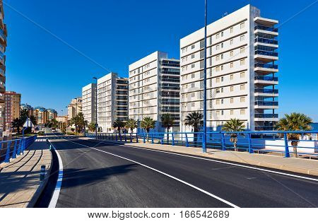 Empty street of La Manga (La Manga del Mar Menor) is a seaside spit in the Region of Murcia Spain.