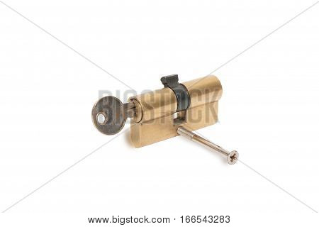 the old lock cylinder with a key isolated on a white background