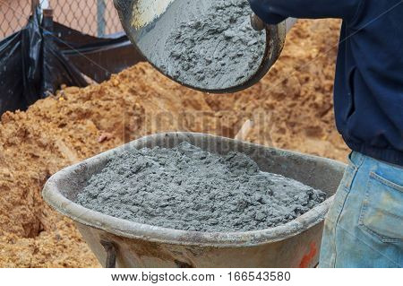 Pouring Wet Cement To Cart At Construction Site