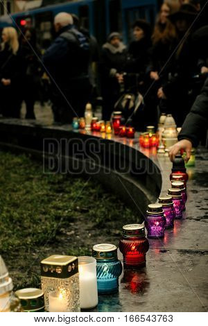 Crowd Of People Lighting Candles In City Center, Mourning Victims In Terrorism Attacks And Revolutio