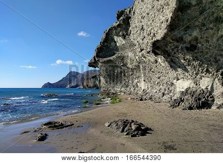 Volcanic rock-formations and crystal clear water at Playa de Monsul. Famous beach in the Cabo de Gata-Nijar Natural Park. Province of Almeria. Spain