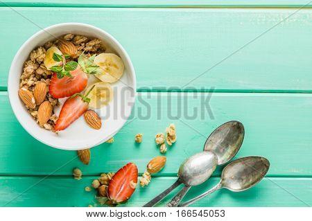 Breakfast - strawberry and banana muesli with yogurt, copy space