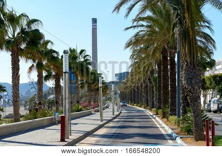 View to the street and chimney of cement factory in Carboneras. Province of Almeria. Spain