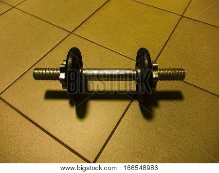 Dumb-bell for bodybuilding and fitness on the floor