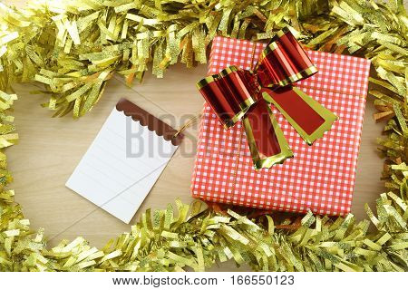 Gift box and Notepad in the concept of Christmas and New Year and special occasions.