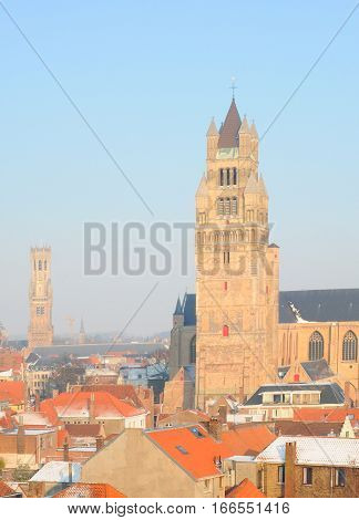 Belfry cathedral and roofs in winter in Bruges Flanders Belgium Europe