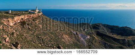 Panorama of a Mesa Roldan Lighthouse and beautiful mountains. Cabo de Gata-Nijar Natural Park Almeria province Andalusia Spain