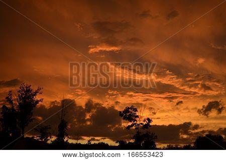 Cloudy orange beautiful yet ominous sky at sunset