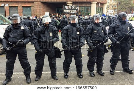 WASHINGTON, Jan. 20, 2017 -- Police in riot gear form a line around detained #DisruptJ20 protesters holding a