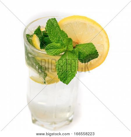 Mojito cocktail with mint and lemon in a highball glass isolated on white background