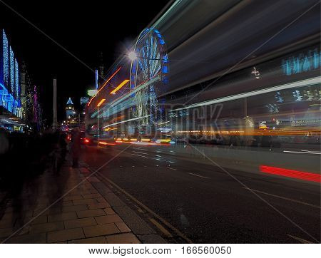 Bus evening from Edinburgh. Edinburgh, Scotland - December 19, 2016 Blurred motion evening bus in the center of Edinburgh, on a background of city buildings.