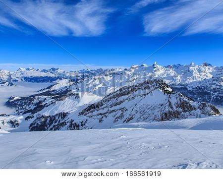 Summits of the Swiss Alps, wintertime view from Fronalpstock mountain in the Swiss Canton of Schwyz.