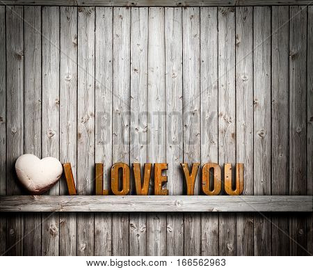 I love you Valentines day. Text and heart stone on wooden background. I love you word and a stone heart stone on wooden shelf on background with wooden boards vertical. 3d text.