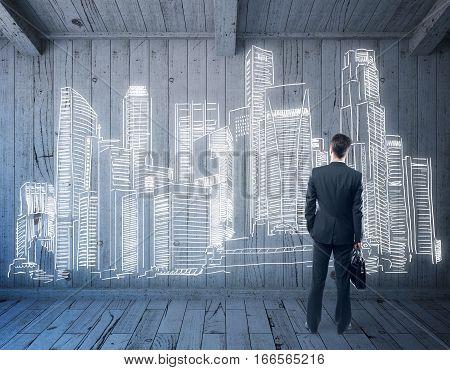 businessman in wooden room looking on creative city sketch. 3D Rendering