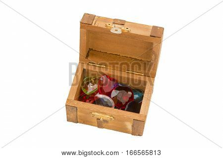 Tiny wooden treasure chest with artificial jewels