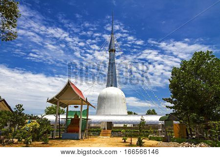 Architecture and blue sky with statue in Chumphon province Thailand.