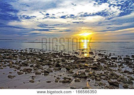 Stone sun dawn morning on Thung Wua Lan Beach at Chumphon Province Thailand.