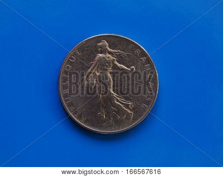 1 Franc Coin, France Over Blue