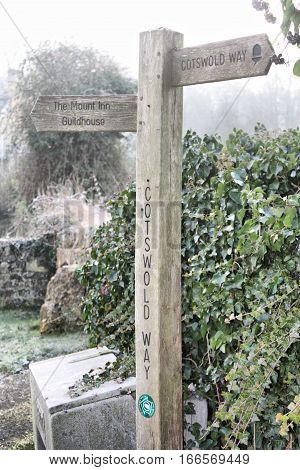 wooden signpost showing the directions of the cotswold way walk
