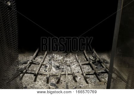 Traditional home fireplace empty full of ashes well used and loved black background ready for text