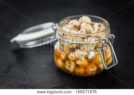 Some Marinated Garlic On A Dark Slate Slab