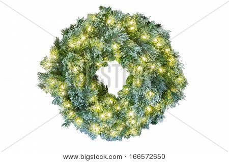 Blue spruce Christmas holiday wreath glowing with white ights