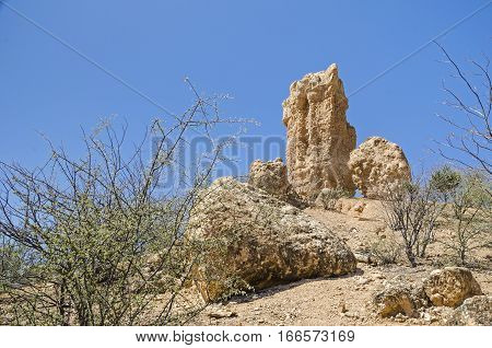 Isolated rocky hills left behind after volcanic activity known as Vingerklip in the valley of Ugab River. Tourist attraction in Damaraland Namibia.