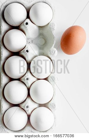 concept of correct choice eggs on white background top view.