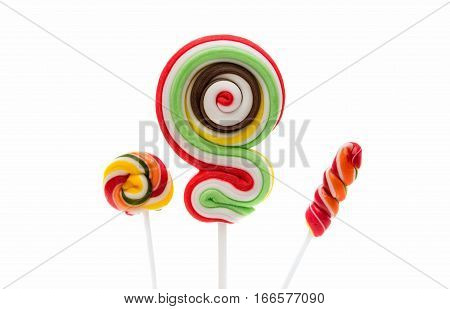 Colorful spiral lollipop lolly pop on a white background